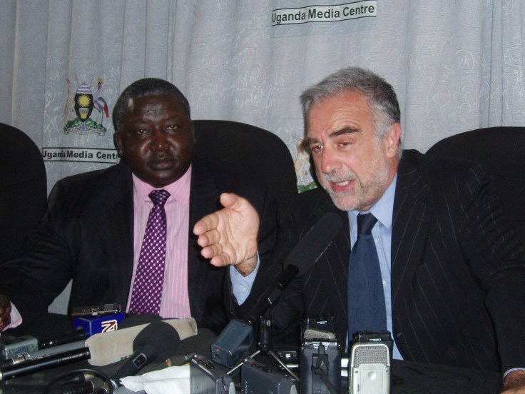 Uganda Minister for International Affairs Henry Okello Oryem and ICC prosecutor Luis Moreno-Ocampo addressiing the press in Kampala on July 13. Rosebell Kagumire photo.