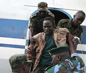 Thomas Kwoyelo getting off a plane at Entebbe Airport from Congo where he was capture. New Vision photo