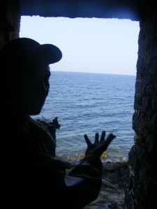 My guide standing at the door of no-return facing the Atlantic. Rosebell Kagumire photo