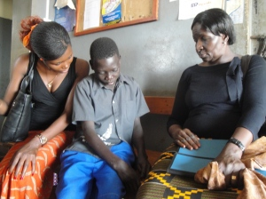 Ruth Ochieng of Isis-WICCE (Right) and Barbra Otuku talking to a 13 year old boy at a police station in Pader. He was arrested, for the 4th time in a year, for defilement. He is primary four, I was in Senior one when I was his age. The Police have no capacity to counsel him so they keep him in cells. He has a single mother who has enough burdens. Rosebell's photo.