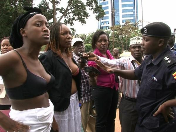 Uganda women protest topless against Police public groping of female politician (2/3)