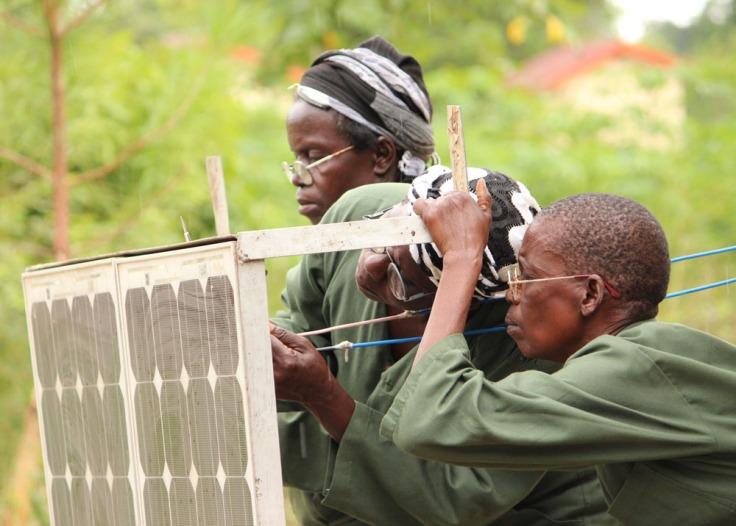 Women fixing a solar panel