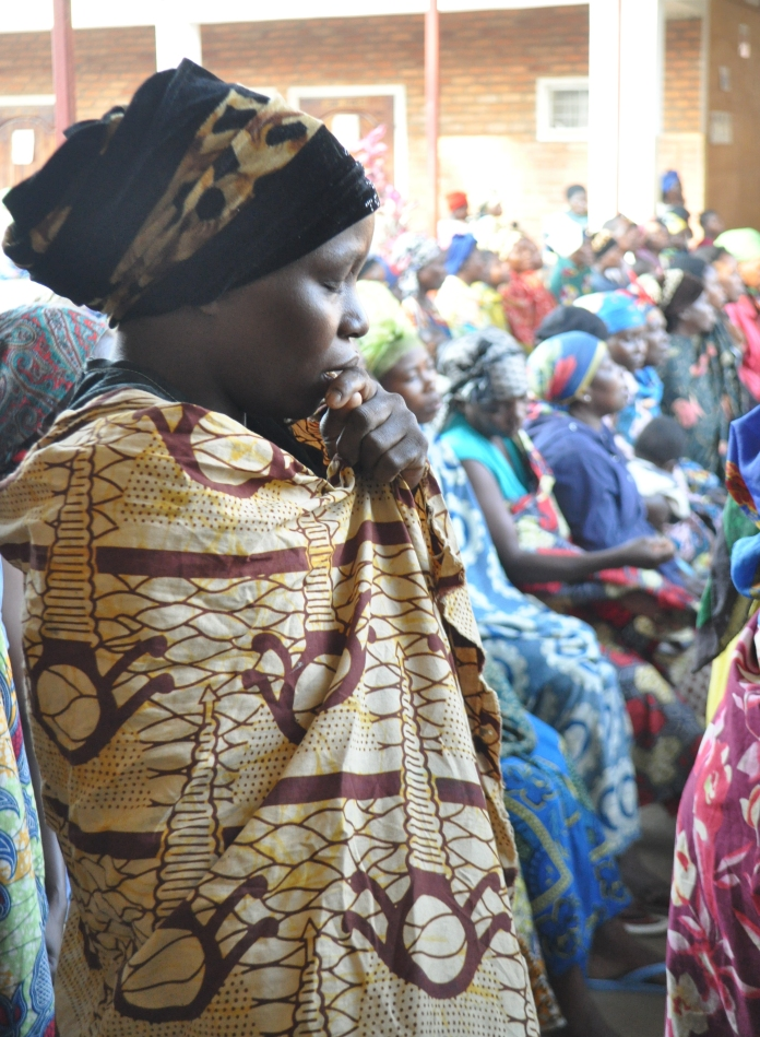 A woman attends a prayer session at Panzi Hospital in Bukavu DRC where hundreds of sexual violence victims are treated every month. Rosebell's photo.
