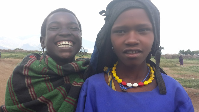 Clementina in her uniform back from school with a friend at a village outside Moroto.