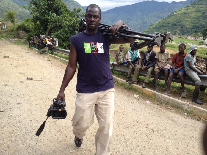 Hillary while covering floods in Kasese, Western Uganda a few months ago.